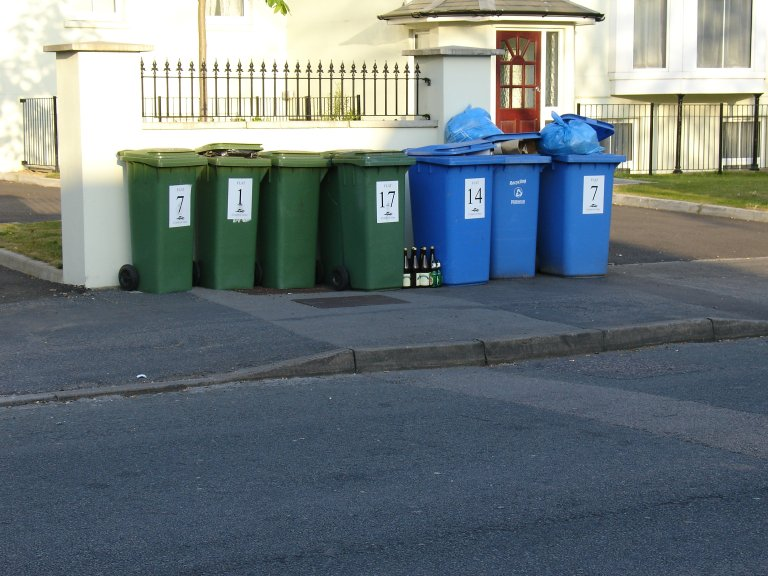 overflowing bins left in the street
